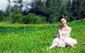 Asian girl sitting in the grass HD wallpaper