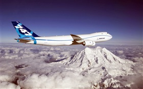 Boeing 747 aircraft, mountain, clouds