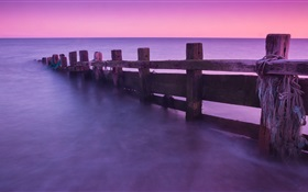 Fence, sea, sunset HD wallpaper