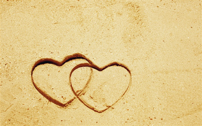 Two love hearts on the sand Wallpapers Pictures Photos Images
