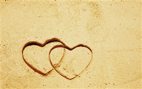 Two love hearts on the sand HD wallpaper