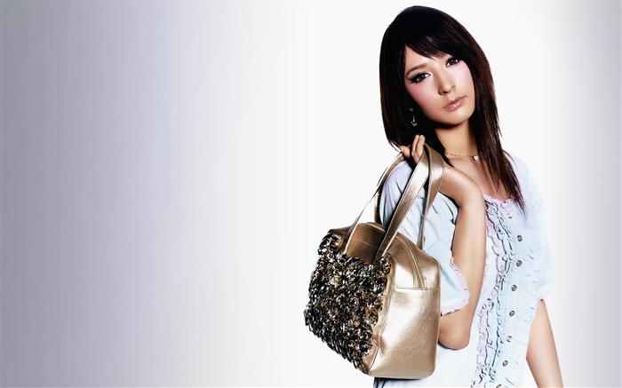 Asian girl, holding a bag Wallpapers Pictures Photos Images