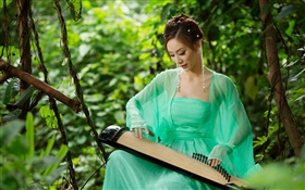 Green dress Asian girl playing the zither HD wallpaper