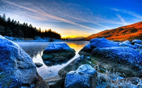 Stones, sunset, trees, volcanic lake HD wallpaper