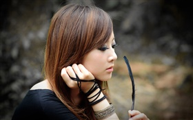 Taiwan girl holding a feather HD wallpaper