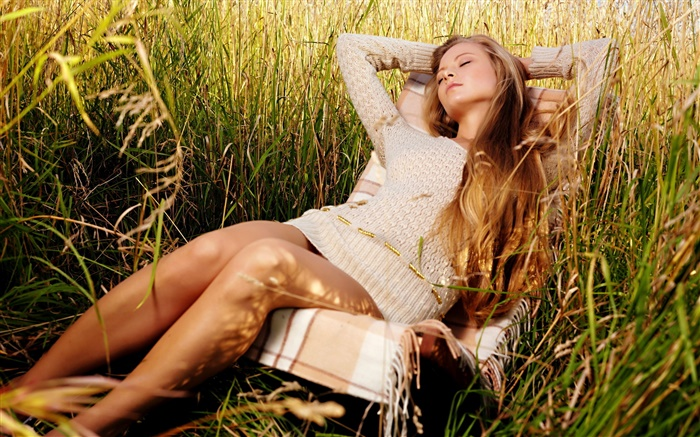 Girl relaxing in the grass Wallpapers Pictures Photos Images