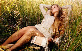 Girl relaxing in the grass HD wallpaper
