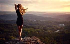 Girl at mountain top, stone, legs, wind HD wallpaper