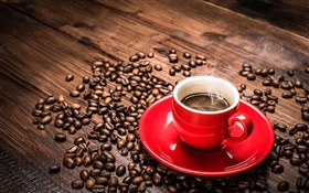 Coffee beans, red cup, saucer, steam