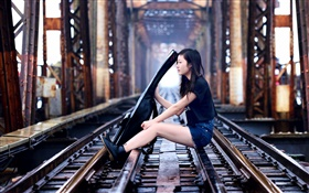 Girl sit at railroad play guitar, bridge HD wallpaper
