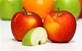 Two red apples, green apple slice, tasty fruit