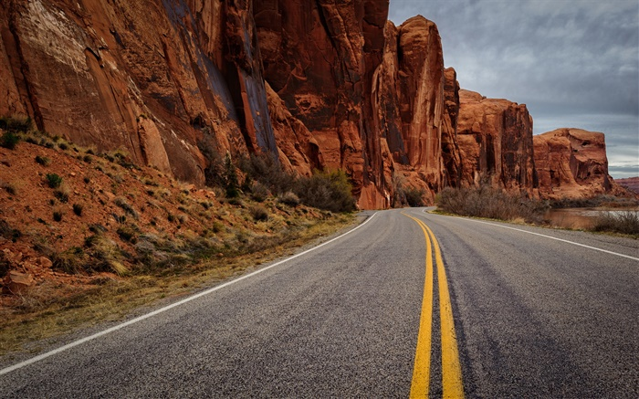 Asphalt road, rock mountains, dusk Wallpapers Pictures Photos Images