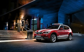 BMW X1 E84 red car at night