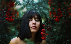 Black hair girl, red berries, bokeh