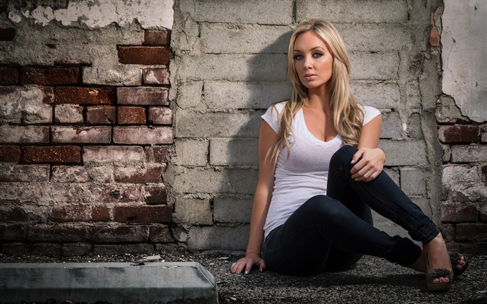 Blonde girl, eyes, sits at wall side Wallpapers Pictures Photos Images