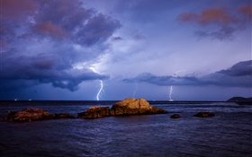 Sea, lightning, storm, stones, night, clouds HD wallpaper