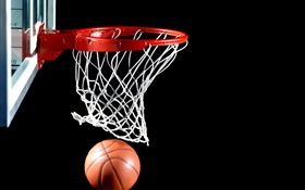 Basketball into the basket, black background HD wallpaper
