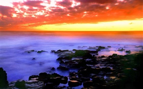 Beautiful red sky, sunset, sea, stones, Hawaii, USA