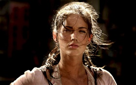 Girl in the wind, black background