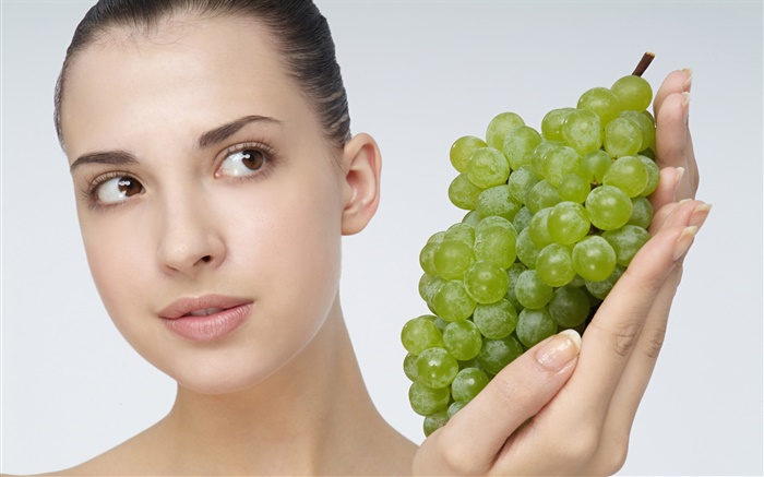 Girl with green grapes Wallpapers Pictures Photos Images