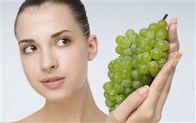 Girl with green grapes HD wallpaper