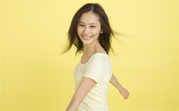 Happy Asian girl, yellow background Wallpapers Pictures Photos Images