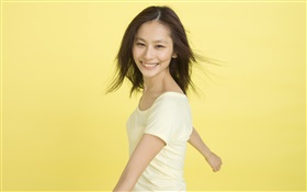Happy Asian girl, yellow background HD wallpaper