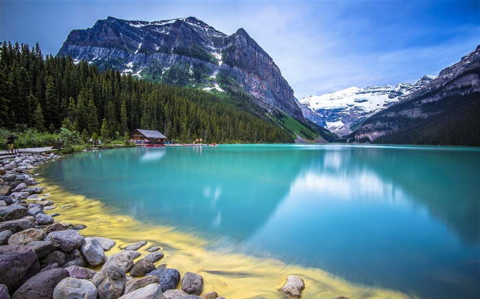 Mountains, trees, lake, house, stones, blue sky Wallpapers Pictures Photos Images