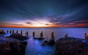 Ocean, coast, sea, fence, rocks, dawn HD wallpaper