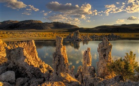 Rocks, lake, hills, plants, sunshine HD wallpaper