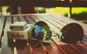 Still life, lighter, cigarette, sunglasses