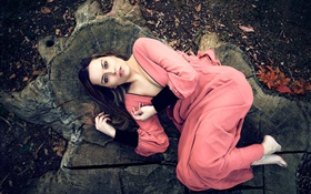 Pink dress girl lying on stump HD wallpaper