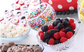 Sweet food, candies, black and red berries