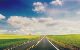 Green grass, road, highway, clouds