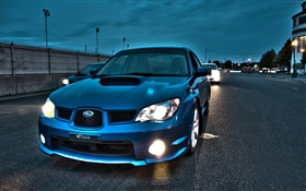 Subaru blue car at evening