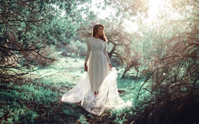 White dress girl in the forest, sun, glare