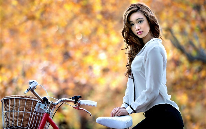 Asian girl and bike in autumn Wallpapers Pictures Photos Images