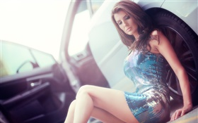 Beautiful girl sitting at car side HD wallpaper