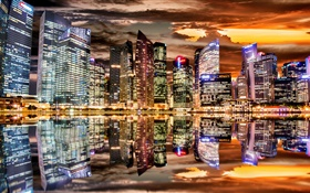 Beautiful city night, skyscrapers, lights, water reflection HD wallpaper
