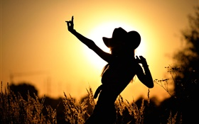 Dance girl at sunset, silhouette