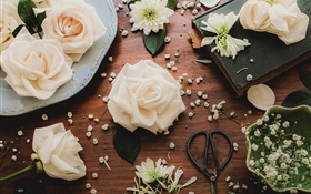Light pink rose flowers, table, scissors