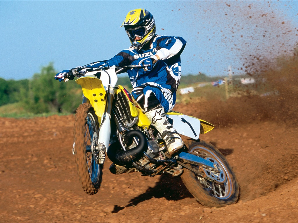 Suzuki motorcycle, racing, jumping 1024x768 wallpaper