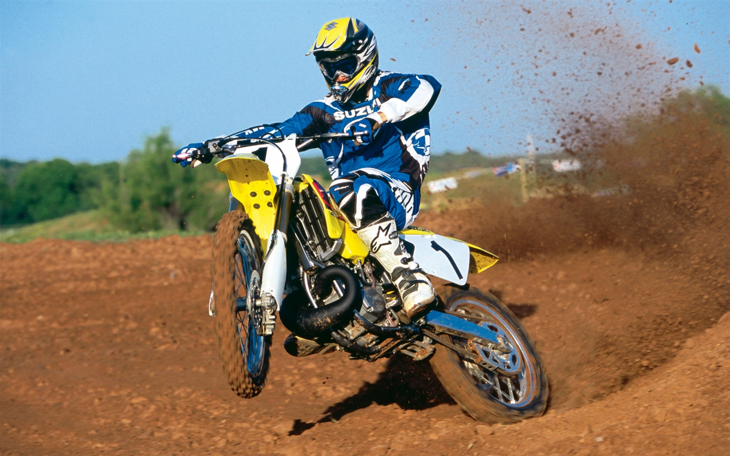 Suzuki motorcycle, racing, jumping 1440x900 wallpaper