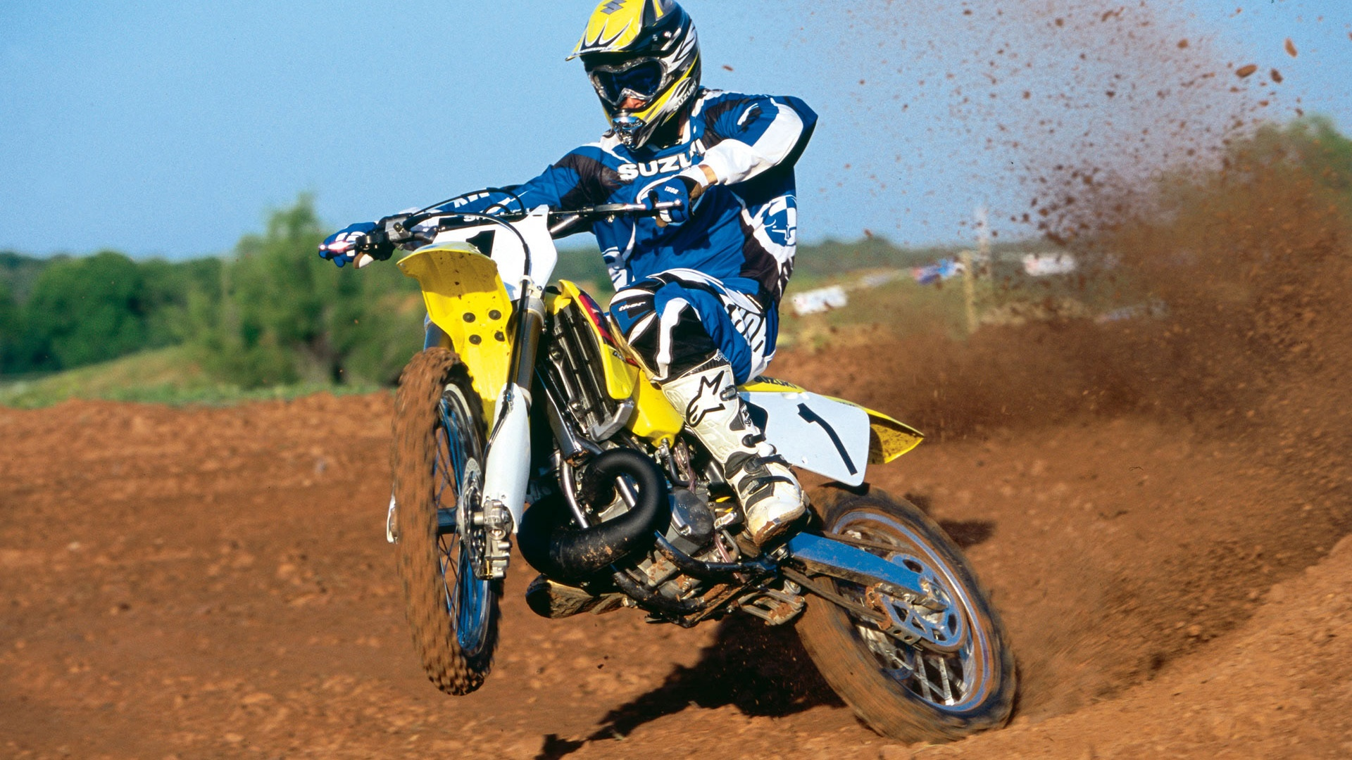 Suzuki motorcycle, racing, jumping 1920x1080 wallpaper