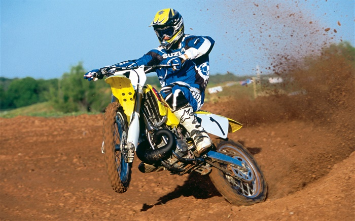 Suzuki motorcycle, racing, jumping Wallpapers Pictures Photos Images