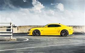 Chevrolet Camaro RS yellow car side view