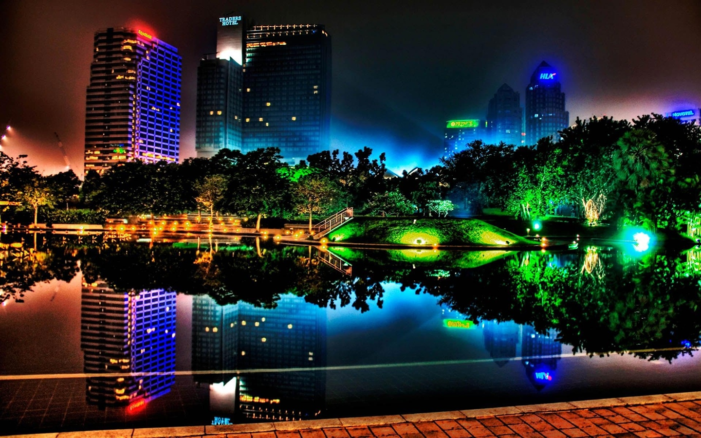 Beautiful night city, buildings, pond, lights, trees, park 1440x900 wallpaper